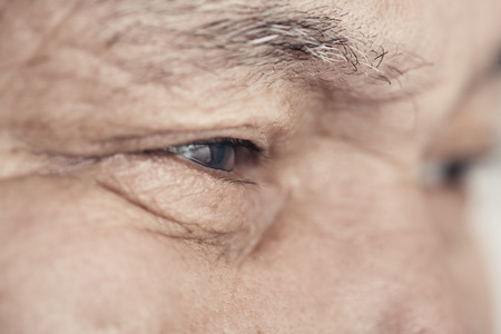 Close-up view on the eye of elderly human Stock Photo