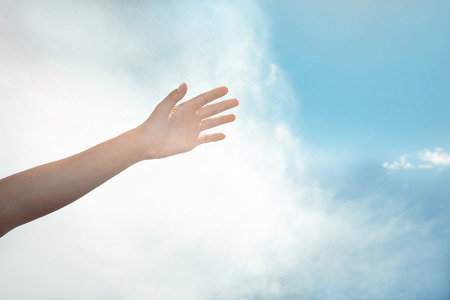 Human hand on a summer sky background Stock Photo