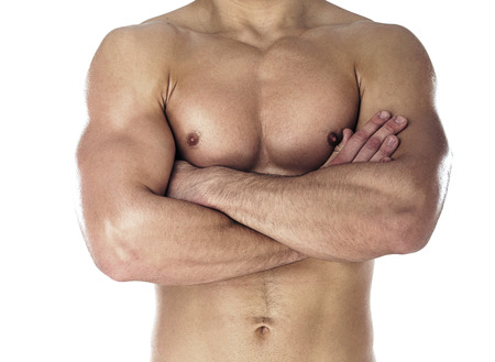 folding arms: Muscular body of sportsman. Horizontal close-up photo Stock Photo