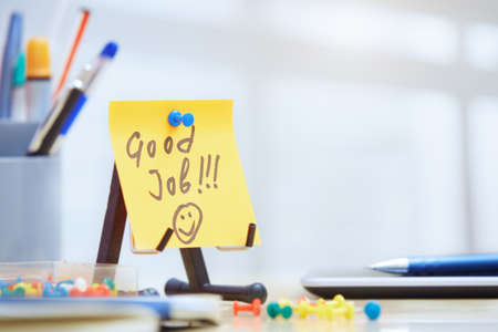good business: Good job text on adhesive note at office