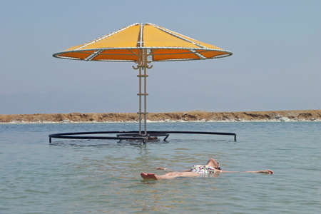 Floating at the Dead Sea, Israel Stock Photo - 217660