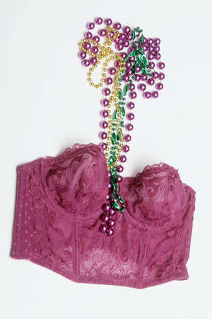 A purple corset and some Mardi Gras beads.