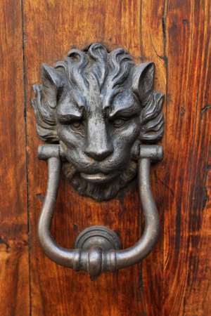 Lion shaped steel door knocker Stock Photo