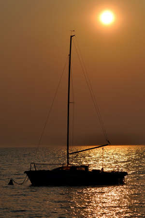 Boat silhouette at sunset Stock Photo - 4662669