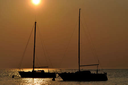 Boats silhouette at sunset Stock Photo - 4662668
