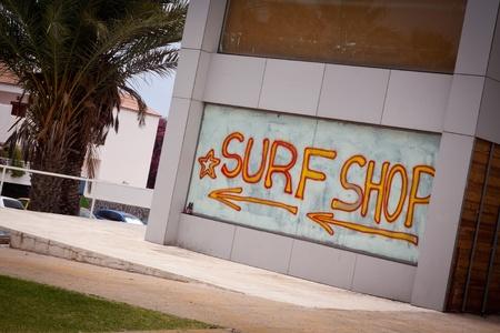 Surf Shop Advertisement. Playa Las Americas, Tenerife, Canary Islands, Spain.