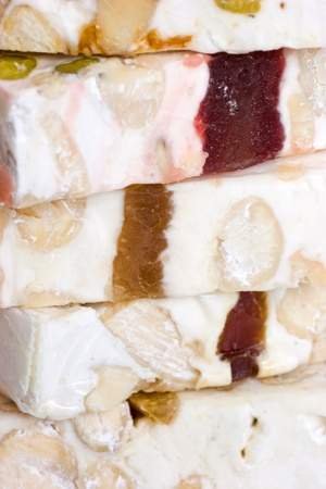 candy corn: Close-up pieces of sliced delicious nougat from Cassis. Extreme close-up macro. Shallow depth of field. Stock Photo