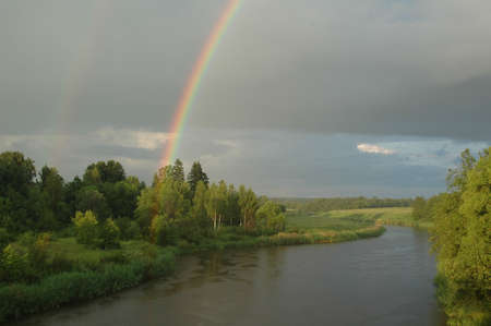inclement weather: The rainbow on river. Russia, Moscow area, river Dubna.