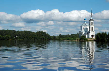 A picturesque white orthodox church sits along the banks of the Volga River in Russia. photo
