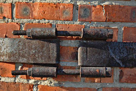 iron hoops: Metal coupler (bandage) on an old brick pipe of a boiler-house