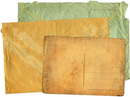 Two greater old envelopes and postcard on a white background photo