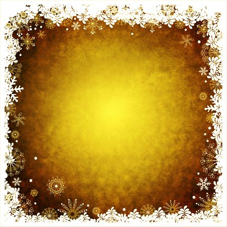 Old yellow paper with white and golden snowflakes photo