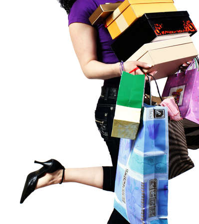 waist-down view of woman carrying shopping bag Stock Photo