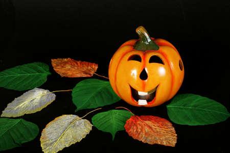 hollows: Merry Halloween pumpkins against black background
