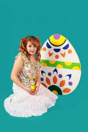 Girl and Easter eggs on blue background
