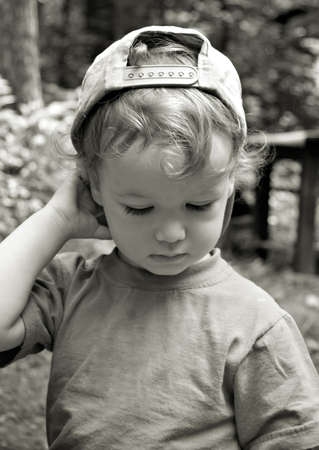 The curly thoughtful kid photo