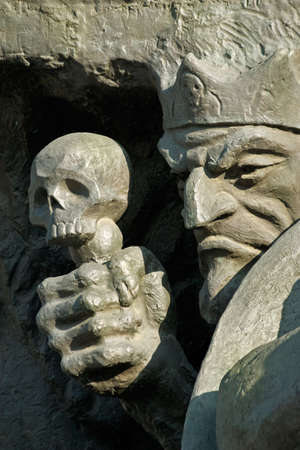 ancient philosophy: Death and skull-fragment of a sculpture in childrens park of fairy tales