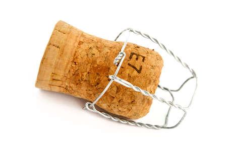 El corcho de champaña sobre un fondo blanco  Foto de archivo - 355431