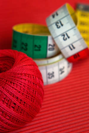 darn: Red, green, yellow -still-life from colourful sewing accessories Stock Photo
