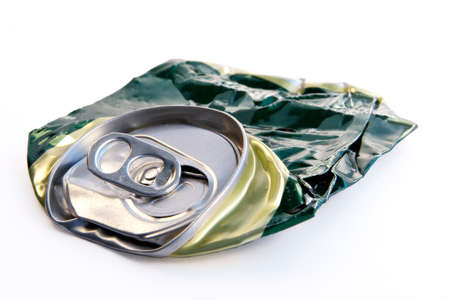 severely: Crushed beer can- life was severely passed after it... Stock Photo