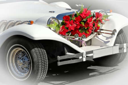 cowl: Wedding attribute-limousine with a bouquet of flowers on a cowl