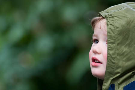 successor: Child on walk in rainy day Stock Photo