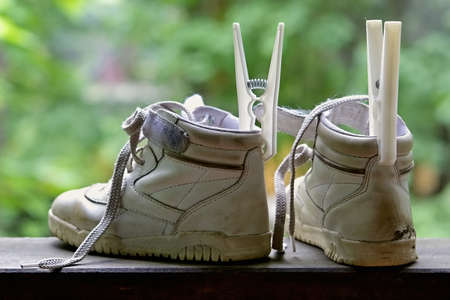hillwalking: Got wet childrens boots after walk on pools Stock Photo