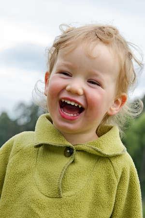 Boy laughs cheerfully photo