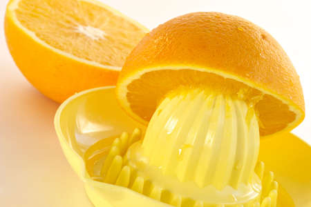 extractor: Manual juice extractor and oranges Stock Photo