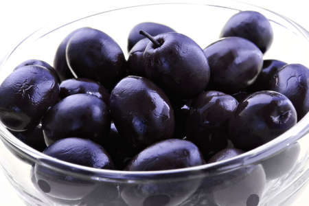 palatable: Black olives-dishes with appetizing snack Stock Photo