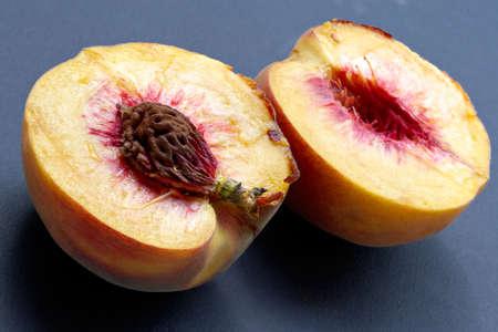 fleshy: Ripe juicy fleshy cut peaches