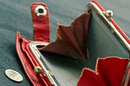 allegoric: Shabby purse with last coin