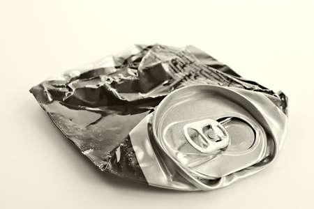 disintegration: Crushed beer can- life was severely passed after it... Stock Photo
