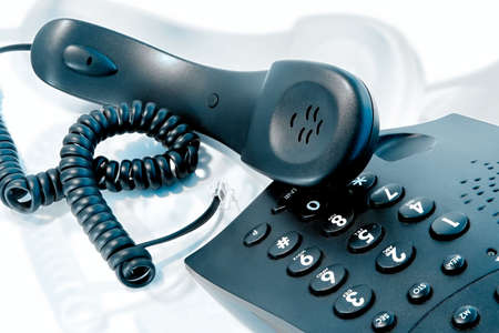 caller: Phone with the twirled cord
