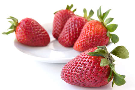 palatable: Appetizing fresh berries of the strawberry which has been spread out for preparation of a celebratory dessert