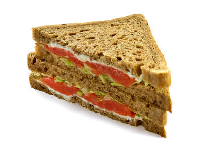 Big sandwich with a salmon, mayonnaise and leaves of green salad photo
