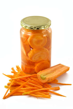 Carrots cut on slices and laid in glass container photo