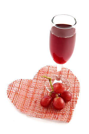 Glass of red wine on a background of heart-romantic appointment enamoured photo