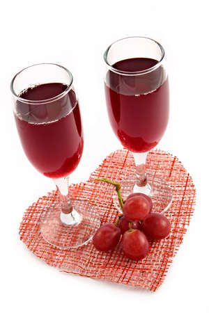 Red wine and grape on a background of heart-romantic appointment enamoured photo
