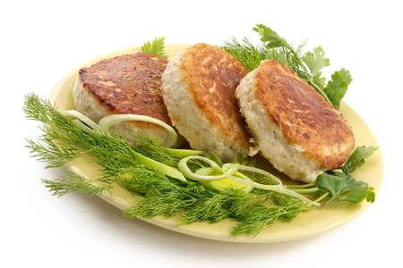 nourishing: Las tajadas de cerdo jugosas con a adornan de verdes. Una cena de alimentaci�n de la alto-caloria Foto de archivo