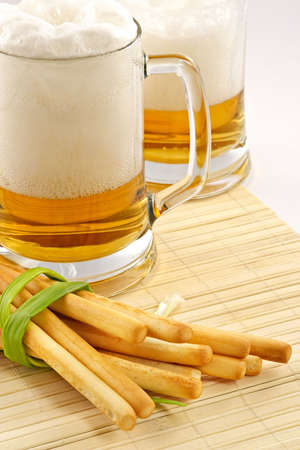grissini: Beer and snack-grain grissini with cheese and an onions Stock Photo
