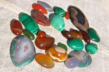 Colourful semiprecious stones a-cornelian, malachite, onyx photo