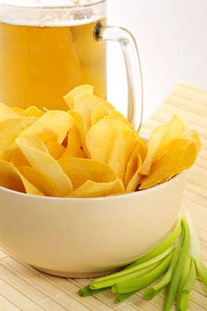 crackling: Snack from crackling potato chips with cheese and an onions-entertainment to beer
