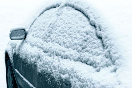 creates: Car during a snowfall in town-snowdrift in city creates greater problems for automobile movement Stock Photo