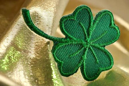 Four leaf clover and shine of gold-skilful manual silk embroidery Stock Photo - 781113
