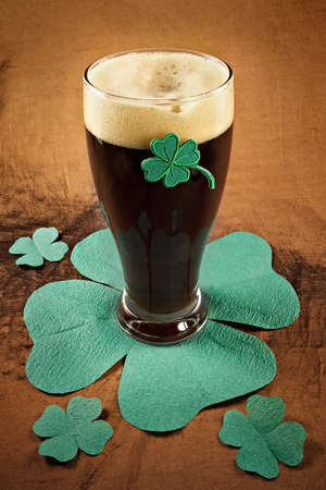 Dark Irish beer for St Patick's Day on napkins stylized under clover leaf Stock Photo - 782048