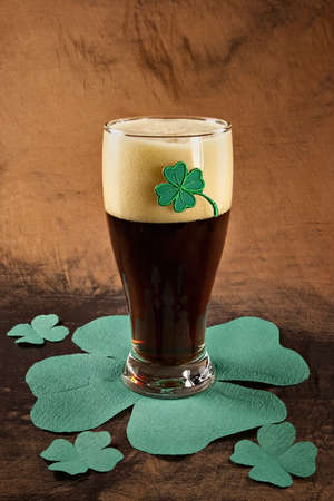 Dark Irish beer for St Patick's Day on napkins stylized under clover leaf Stock Photo - 782047