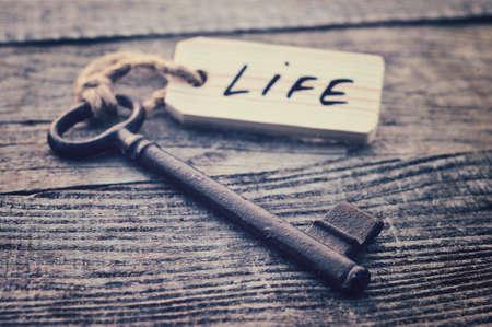 Key and label. Life concept Фото со стока