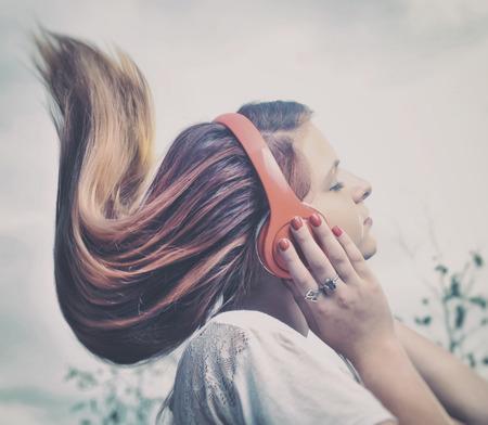 Girl is listen to the music on headphones