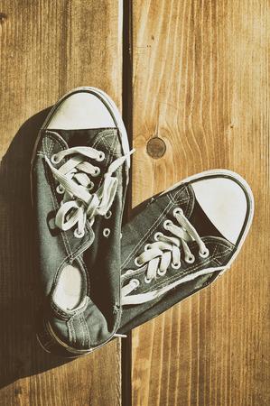 Sneakers on floor on wooden  photo